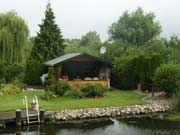 A typical canalside gardenand summerhouse