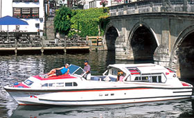 Cruise the River Thames under bridges and through historic villages